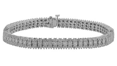 12.09 Ct. TW Round Diamond Tennis Bracelet in Triple Row 14 kt. Mounting
