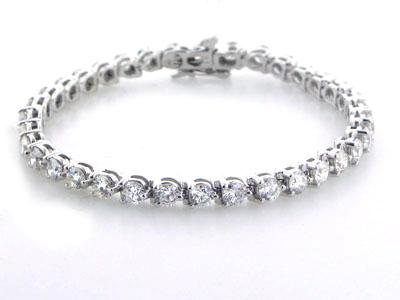 4.50 Ct. TW Round Diamond Tennis Bracelet in 14 kt. Three Prong Mounting
