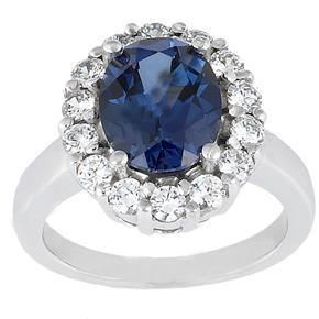 8.85 ct. TW Oval Shape Blue Sapphire in Diamond Accented 14 kt. White Gold Ring